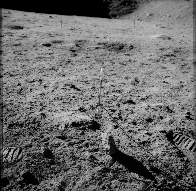 AS12-49-7197 - Apollo 12 - Apollo 12 Mission image  - View of a core sampler on the lunar surface