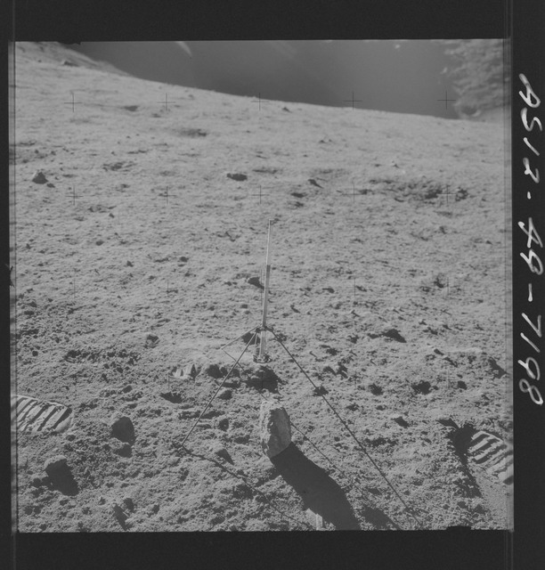 AS12-49-7198 - Apollo 12 - Apollo 12 Mission image  - View of a core sampler on the lunar surface