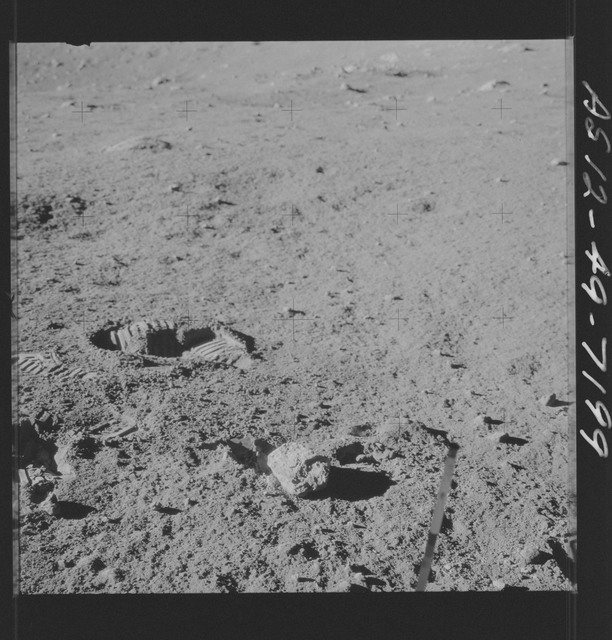 AS12-49-7199 - Apollo 12 - Apollo 12 Mission image  - View of a core sampler on the lunar surface