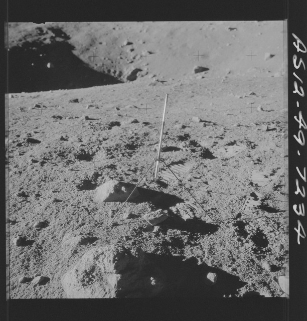 AS12-49-7234 - Apollo 12 - Apollo 12 Mission image  - View of a Core Sampler in Bench Crater