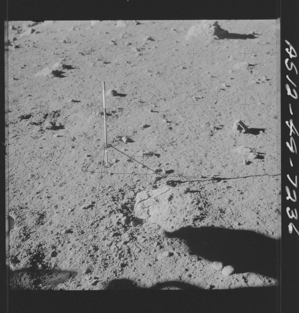 AS12-49-7236 - Apollo 12 - Apollo 12 Mission image  - View of a Core Sampler in Bench Crater