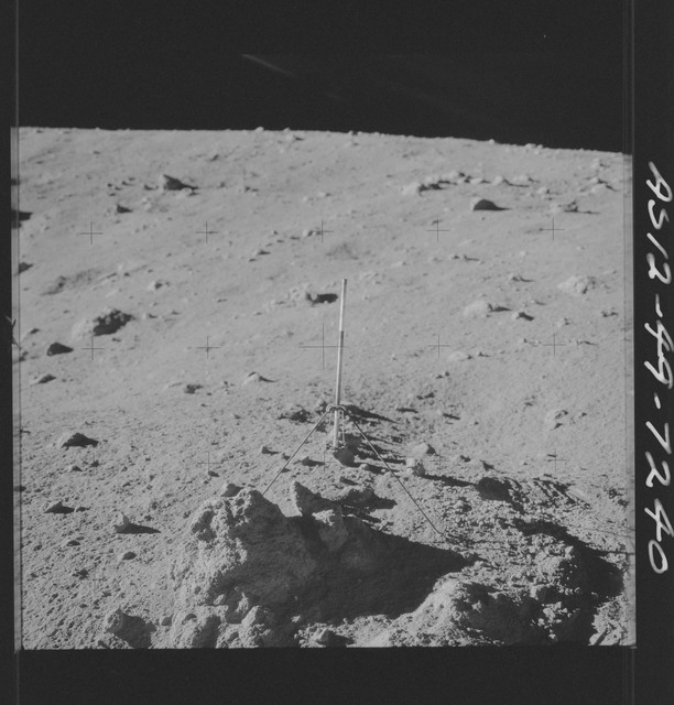 AS12-49-7240 - Apollo 12 - Apollo 12 Mission image  - View of a Core Sampler in Bench Crater