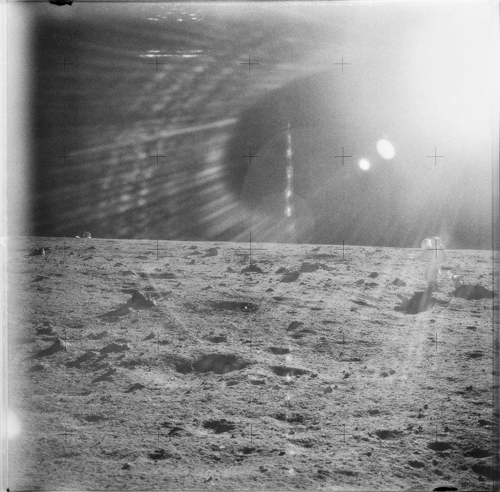 AS12-49-7246 - Apollo 12 - Apollo 12 Mission image  - Astronaut Alan L. Bean, lunar module pilot, is photographed on the Lunar terrain.