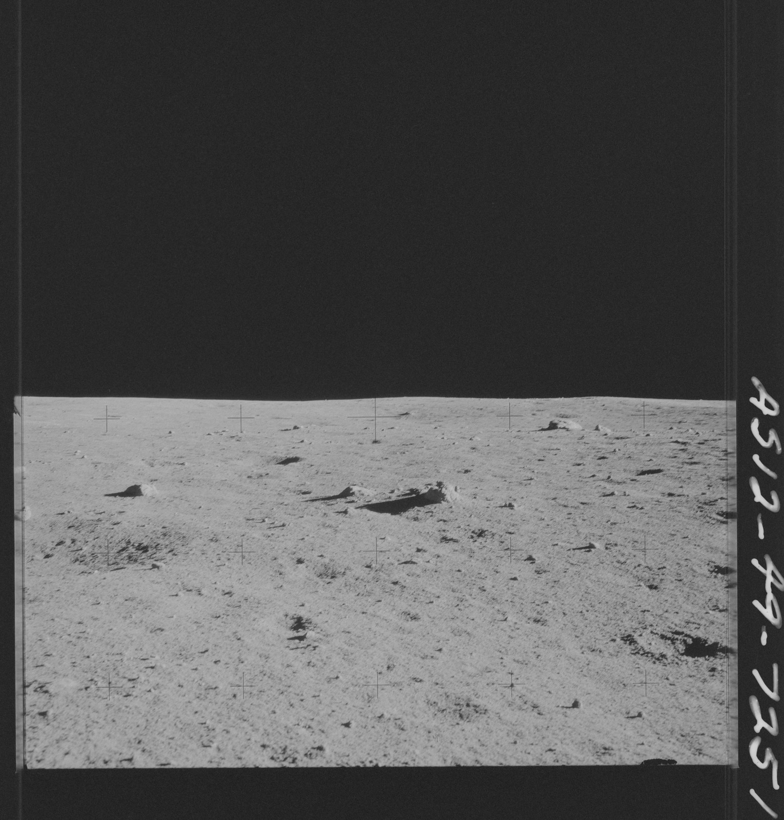 AS12-49-7251 - Apollo 12 - Apollo 12 Mission image  - View of the Lunar terrain