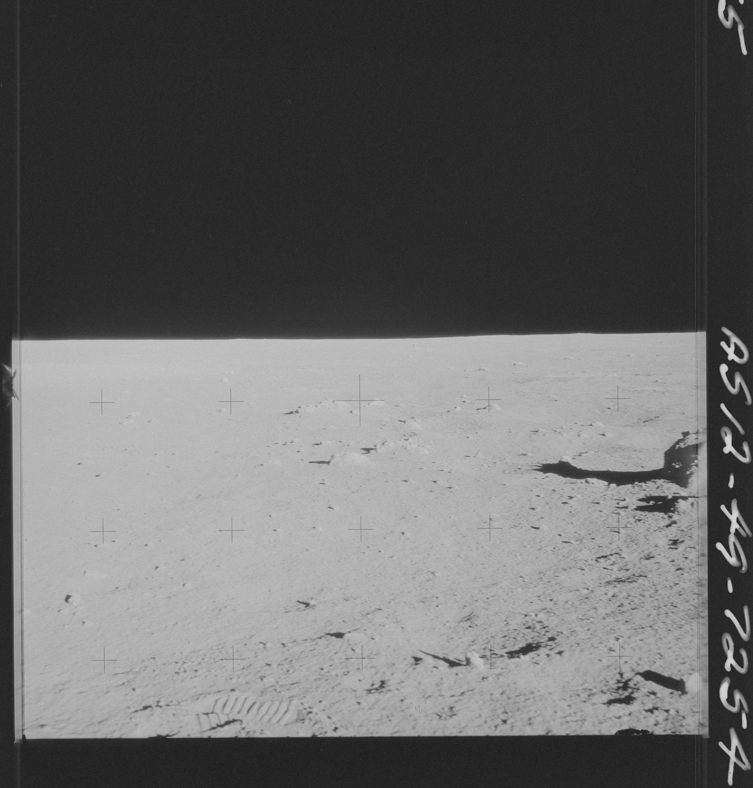 AS12-49-7254 - Apollo 12 - Apollo 12 Mission image  - View of the Lunar terrain