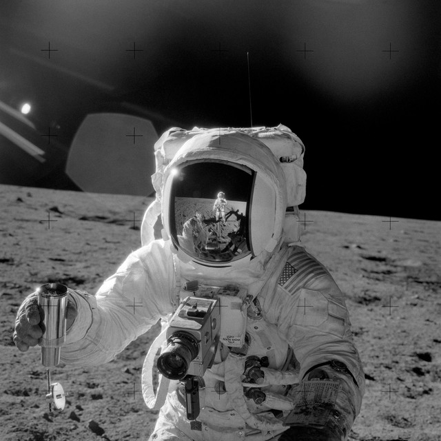 AS12-49-7278 - Apollo 12 - Apollo 12 Mission image  - Astronaut Alan L. Bean holds a Special Environmental Sample Container