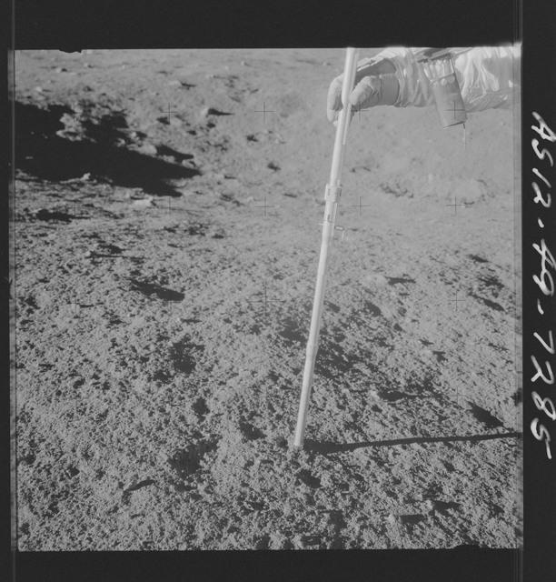 AS12-49-7285 - Apollo 12 - Apollo 12 Mission image  - View of a Core Sampler near Halo Crater