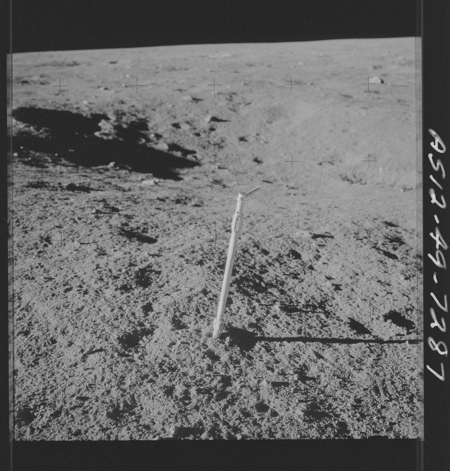 AS12-49-7287 - Apollo 12 - Apollo 12 Mission image  - View of a Core Sampler near Halo Crater