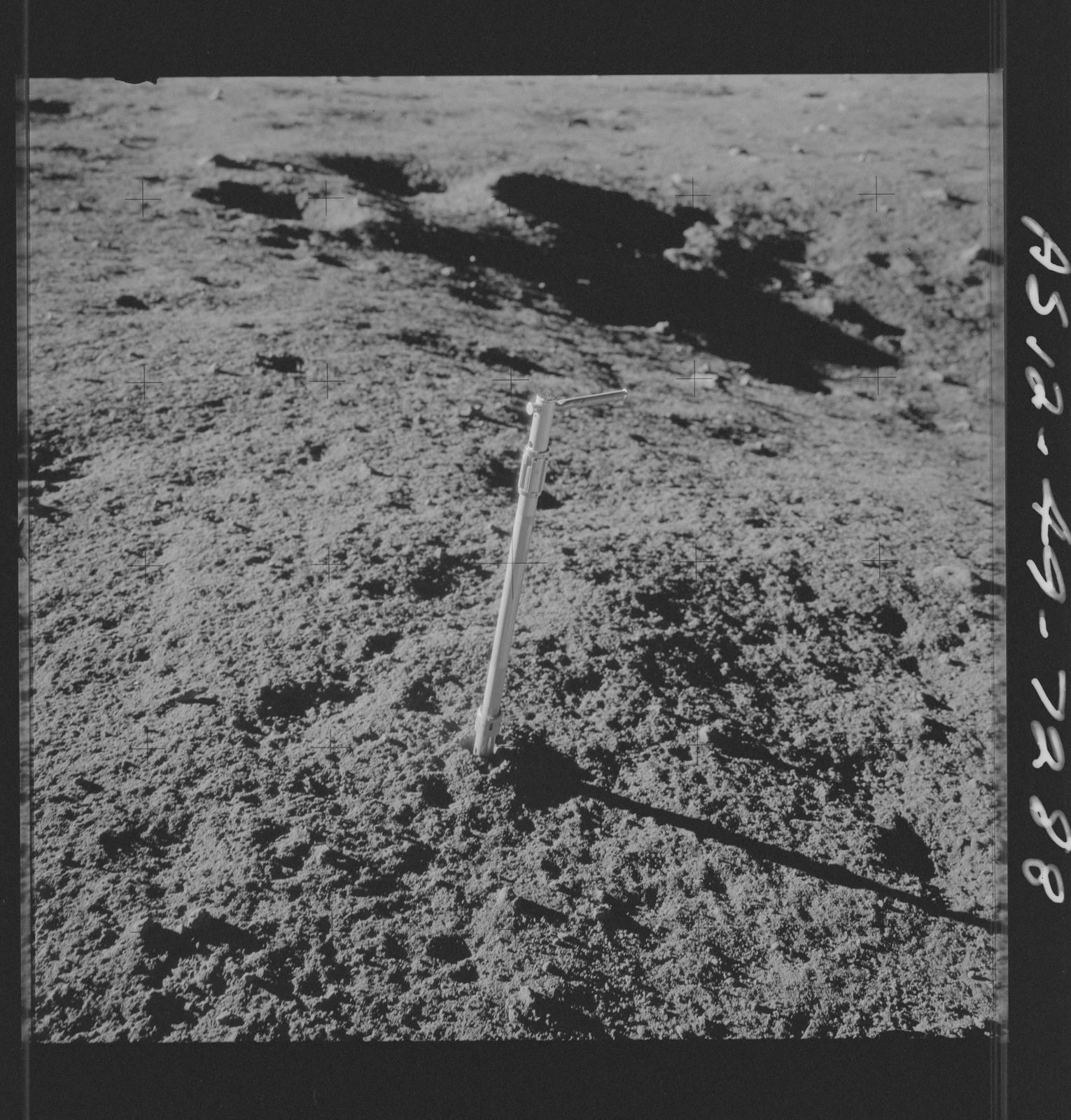 AS12-49-7288 - Apollo 12 - Apollo 12 Mission image  - View of a Core Sampler near Halo Crater