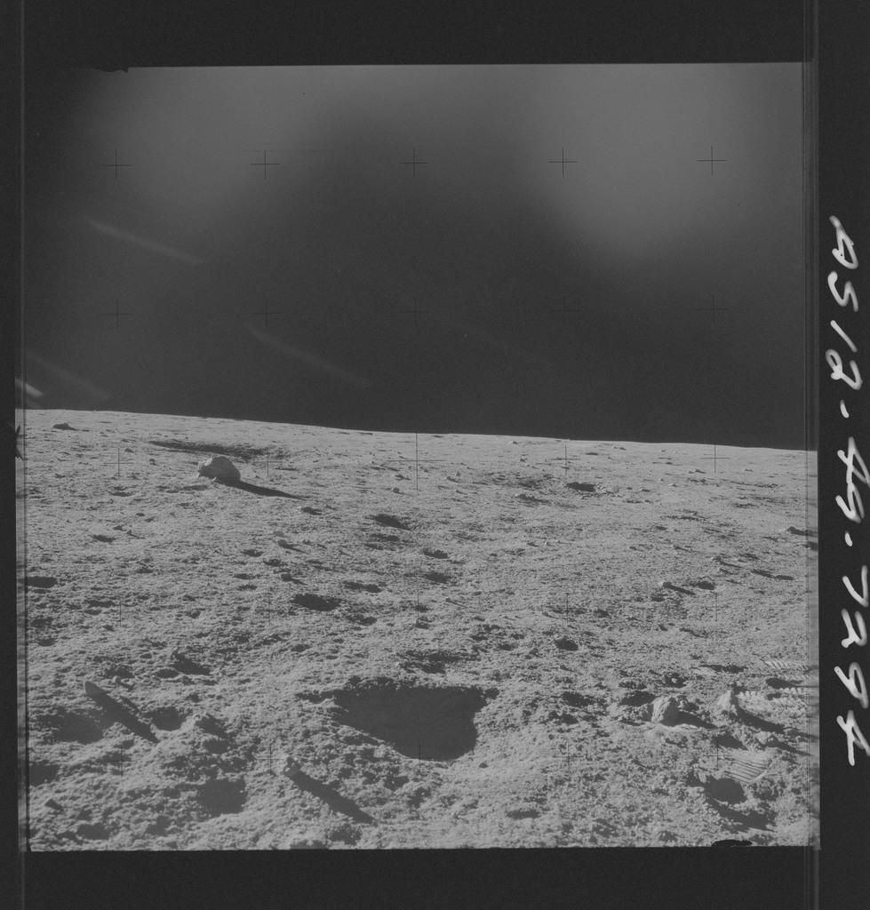 AS12-49-7294 - Apollo 12 - Apollo 12 Mission image  - View of the Lunar terrain