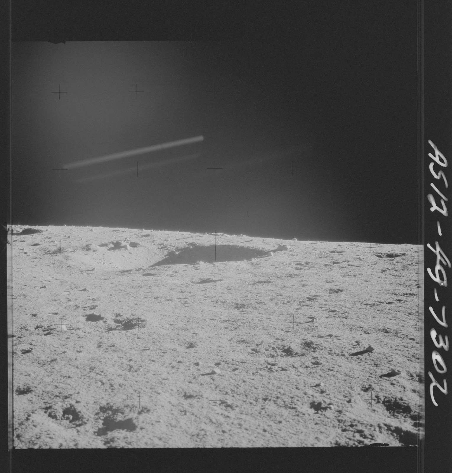 AS12-49-7302 - Apollo 12 - Apollo 12 Mission image  - View of the Lunar terrain
