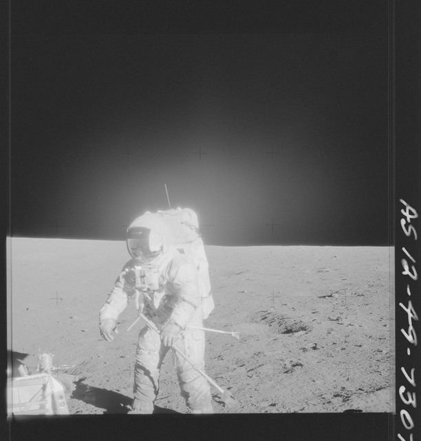 AS12-49-7307 - Apollo 12 - Apollo 12 Mission image  - View of crewmember and Hand Tool Kit