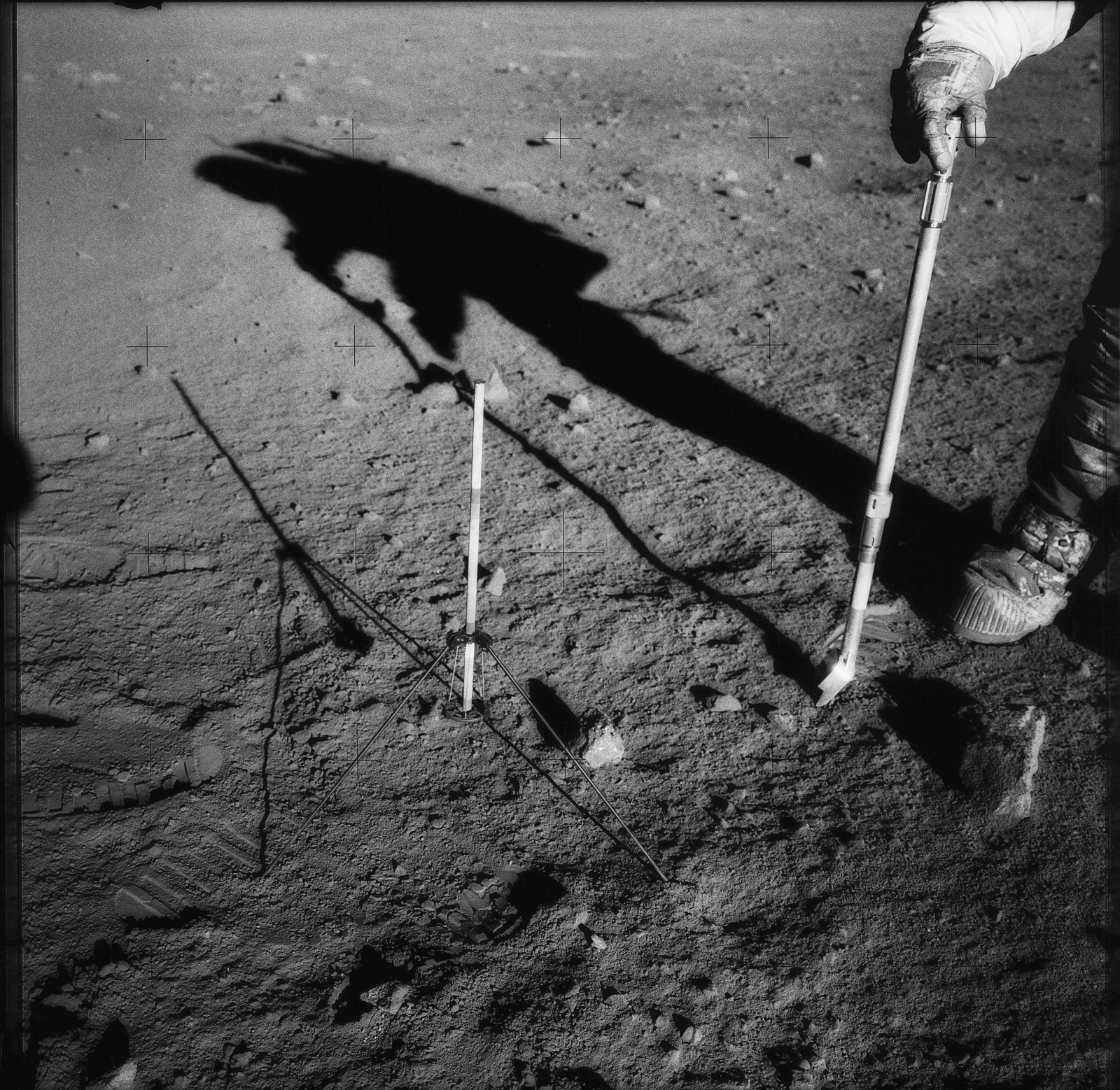 AS12-49-7313 - Apollo 12 - Apollo 12 Mission image  - Charles Conrad Jr., commander, is photographed collection rocks