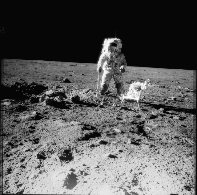 AS12-49-7318 - Apollo 12 - Apollo 12 Mission image  - Charles Conrad Jr., commander, is photographed beside the Handtool Carrier