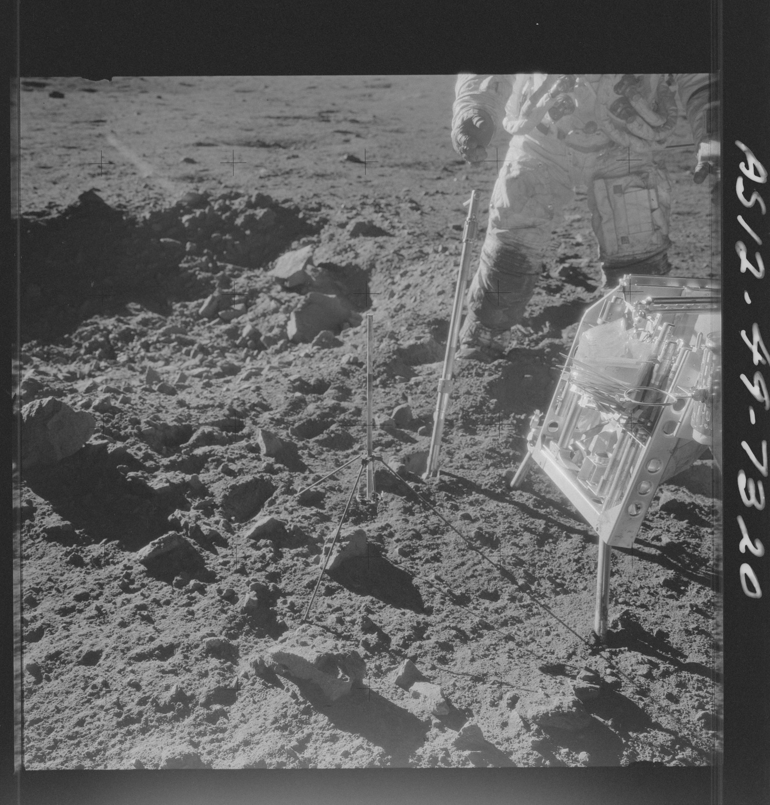 AS12-49-7320 - Apollo 12 - Apollo 12 Mission image  - Charles Conrad Jr., commander, is photographed beside the Handtool Carrier