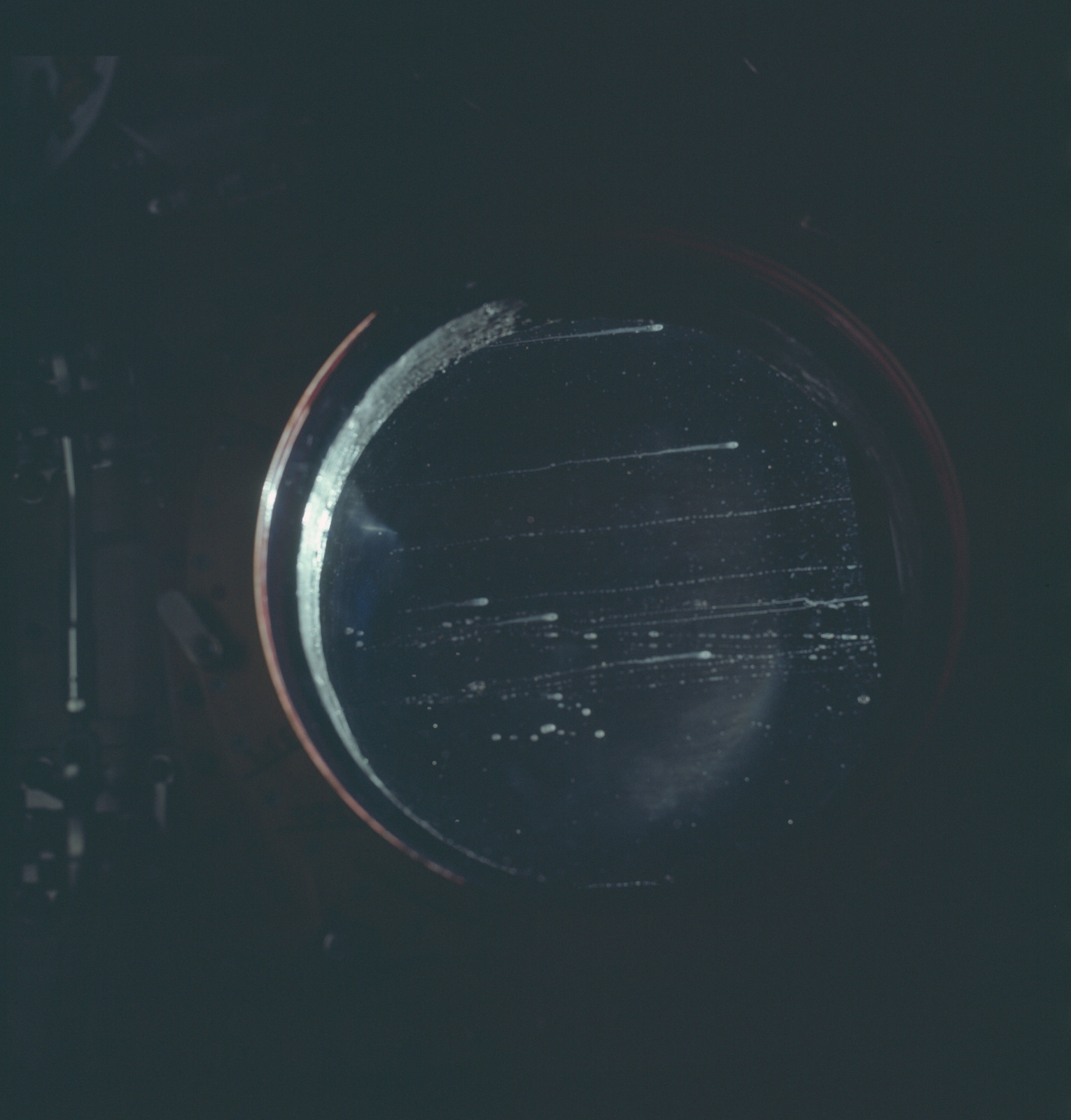 AS12-50-7368 - Apollo 12 - Apollo 12 Mission image  - View of fouled hatch window