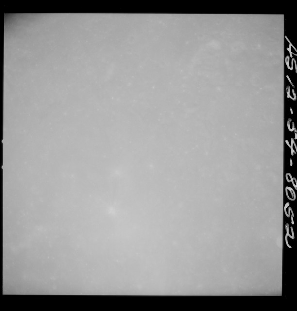 AS12-54-8052 - Apollo 12 - Apollo 12 Mission image  - Near vertical stereo strip view of south end of 3/4 of Crater Dolland B