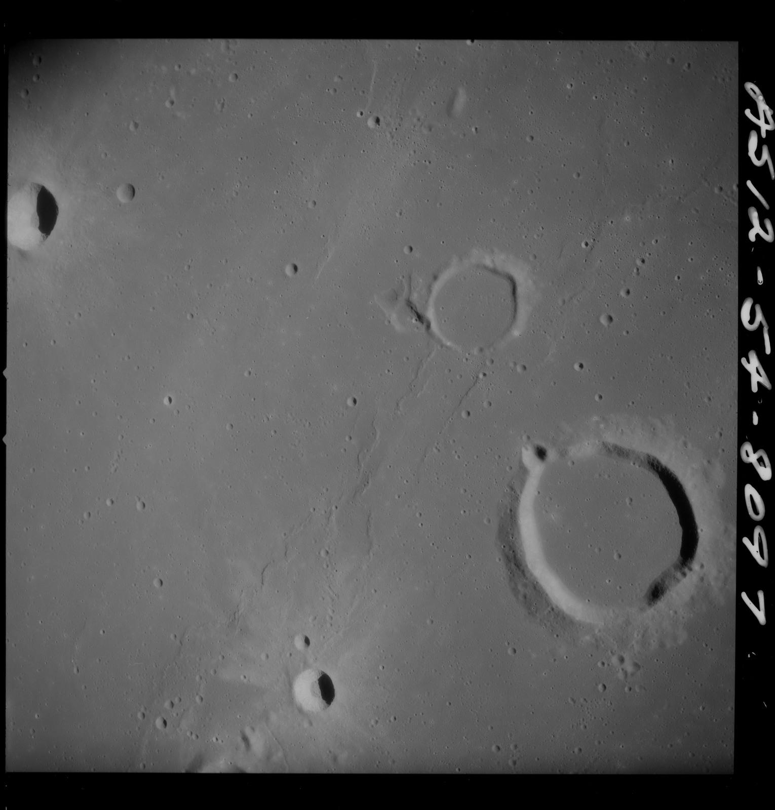 AS12-54-8097 - Apollo 12 - Apollo 12 Mission image  - Near vertical stereo strip view of the southern half of Lansberg Crater