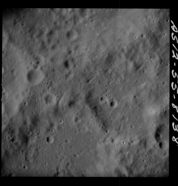 AS12-55-8138 - Apollo 12 - Apollo 12 Mission image  - View Southeast of Crater Wyld and South southwest of Crater Saha