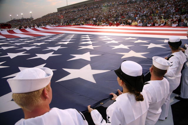 060805-N-3271W-006 (Aug. 5, 2006)US Navy (USN) Sailors from the Navy Operational Support Center Indianapolis and Navy Recruiting Command unfurl a huge American Flag during opening ceremonies for National Association for Stock Car Auto Racing (NASCAR) Kroger 200 at O'Reilly Raceway Park, Indianapolis (IN). The Sailors are present in Indianapolis in conjunction with Navy Week. Twenty-six such weeks are planned in cities throughout the US arranged by the Navy Office of Community Outreach (NAVCO). NAVCO is a unit tasked with enhancing the Navy brand image in areas with limited exposure to the Navy.U.S. Navy official photo by CHIEF Mass Communication SPECIALIST Gary Ward (RELEASED)
