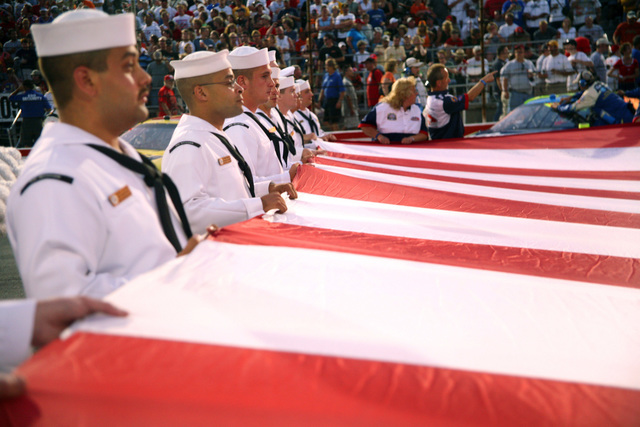 060805-N-3271W-008 (Aug. 5, 2006)US Navy (USN) Sailors from the Navy Operational Support Center Indianapolis and Navy Recruiting Command display a huge American Flag during opening ceremonies for National Association for Stock Car Auto Racing (NASCAR) Kroger 200 at O'Reilly Raceway Park, Indianapolis (IN). The Sailors are present in Indianapolis in conjunction with Navy Week. Twenty-six such weeks are planned in cities throughout the US arranged by the Navy Office of Community Outreach (NAVCO). NAVCO is a unit tasked with enhancing the Navy brand image in areas with limited exposure to the Navy.U.S. Navy official photo by CHIEF Mass Communication SPECIALIST Gary Ward (RELEASED)