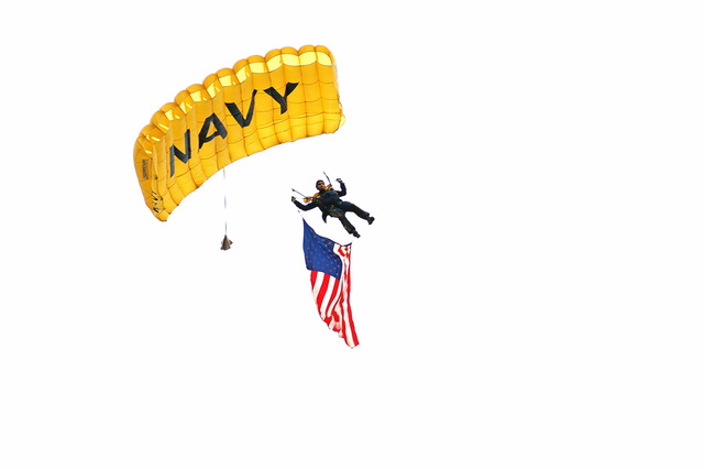 "A member of the US Navy (USN) Parachute Demonstration Team""Leapfrogs""performs as a part of Navy Week Chicago, Illinois (IL). Navy Week Chicago is one of 20 Navy Week events planned this year by the Navy Office of Community Outreach, for various Cities through out the Country"