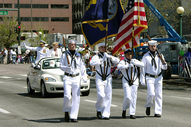 A US Navy (USN) Color Guard, from Navy Reserve Center, Buckley Air Force Base (AFB), Colorado (CO), leads USN Rear Admiral (RADM) Albert Garcia III, Deputy Commander, 1ST Naval Construction Division, in the parade during the Cinco de Mayo Celebration held in, Denver, Colorado (CO). Sponsored by the Navy Office of Community Outreach, Navy Week Denver is one of 20 such weeks planned this year in cities throughout the Country