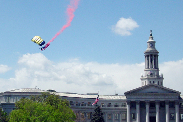 "A US Navy (USN) Parachute Demonstration Team, ""Leap Frogs,"" crew member descends into Civic Park near City Hall, during Denver Navy Week and Cinco de Mayo festivities. Navy Week - Denver is one of 20 such events, arranged by the Navy Office of Community Outreach (NAVCO), planned for the year in cities throughout the US"
