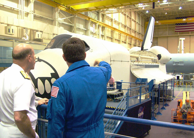 Deputy CHIEF of Naval Operations for Resources, Requirements and Assessments US Navy (USN) Vice Admiral (VADM) Lewis W. Crenshaw, Jr., tours the Johnson Space Center in Houston, Texas (TX), during Navy Week Houston. Sponsored by the Navy Office of Community Outreach, twenty such weeks are planned this year in cities throughout the Country