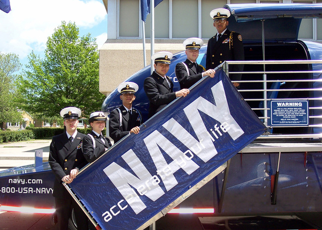 Naval Junior Reserve Officer Training Corps (NJROTC) students from William Howard Taft High School in Chicago, Illinois (IL), pose for a photograph as they prepare to ride the US Navy (USN) F/A-18 Hornet aircraft Flight Simulation, during Navy Week Chicago. Sponsored by the Navy Office of Community Outreach, twenty such weeks are planned this year in cities throughout the Country