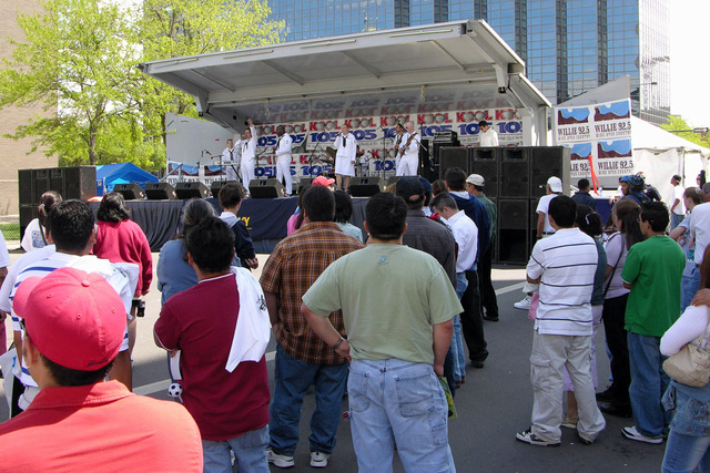 Spectators gather and watch as the US Navy (USN) Band of the Southwest performs during Cinco de Mayo Celebration held at Civic Park, Denver, Colorado (CO). Sponsored by the Navy Office of Community Outreach, Navy Week Denver is one of 20 such weeks planned this year in cities throughout the Country