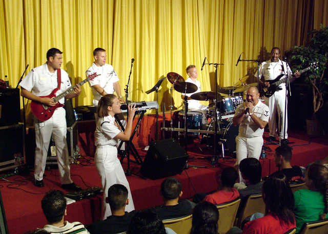 The US Navy (USN) Band of New Orleans entertains students at the Guthrie Center for Excellence High School, located in Houston, Texas (TX). The high-energy group of professional USN Musicians was invited to the school during Navy Week Houston. Sponsored by the Navy Office of Community Outreach, twenty such weeks are planned this year in cities throughout the Country