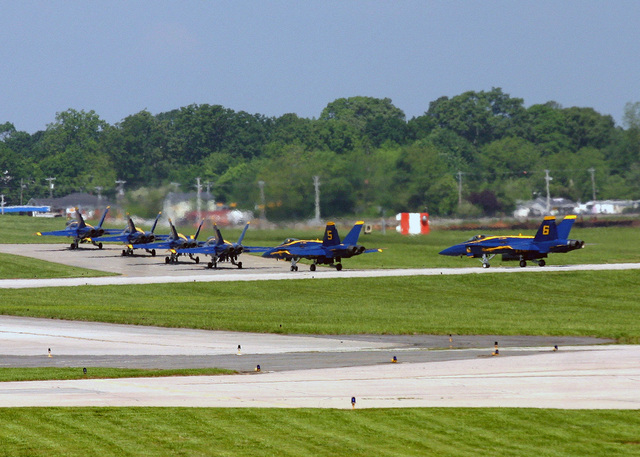 The US Navy (USN) Blue Angels F/A-18C Hornet Flight Demonstration Team aircraft taxis onto the ramp following a performance during the Angels Over Atlanta 2006 Air Show at Naval Air Station (NAS) Atlanta, Georgia (GA). The Blue Angels were the featured act as part of the Atlanta Navy Week 2006. Twenty such weeks planned by the Navy Office of Community Outreach are scheduled to visit cities throughout the Country