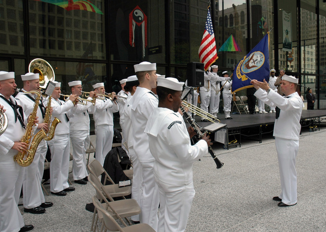 The US Navy (USN) Great Lakes Navy Band plays the National Anthem during the presentation of the Colors, in front of Daley Plaza in downtown Chicago, Illinois (IL). City officials presented Navy Recruiting District Commanding Officer, USN Commander (CDR) Shawn Callahan with Mayor Richard Daley's proclamation designating May 15-20 as Navy Week Chicago. Sponsored by the Navy Office of Community Outreach, twenty such weeks are planned this year in cities throughout the Country