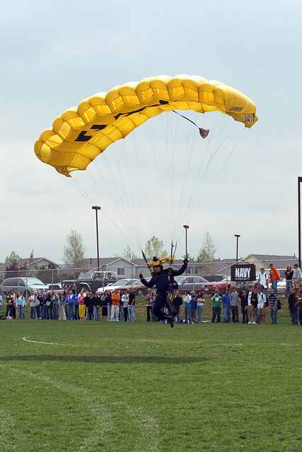 "The US Navy (USN) Parachute Team, ""The Leap Frogs,"" perform for more than 500 students and staff at Highlands Ranch High School (HS) as a part of Denver Navy Week. Navy Week - Denver is one of 20 such events, arranged by the Navy Office of Community Outreach (NAVCO), planned for the year in cities throughout the US"
