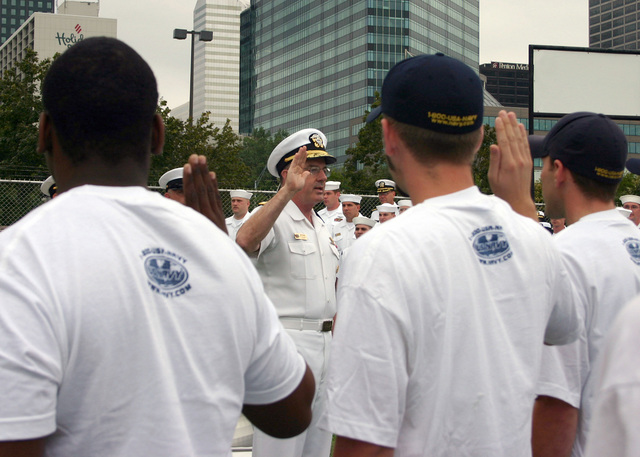 U.S. Navy CHIEF of Naval Personnel Vice Adm. John C. Harvey Jr. administers the oath of enlistment to Navy Recruiting District (NRD) Ohio delayed entry program recruits at the USS COD Museum located along the shores of Lake Erie during Navy Week festivities in Cleveland, Ohio, on Aug. 29, 2006. Twenty-six such Navy Weeks are planned this year in cities throughout the U.S. arranged by the Navy Office of Community Outreach (NAVCO). NAVCO's mission is to enhance the Navy's brand image in areas with limited exposure to the Navy. (U.S. Navy photo by Mass Communication SPECIALIST 2nd Class Michael Sheehan) (Released)