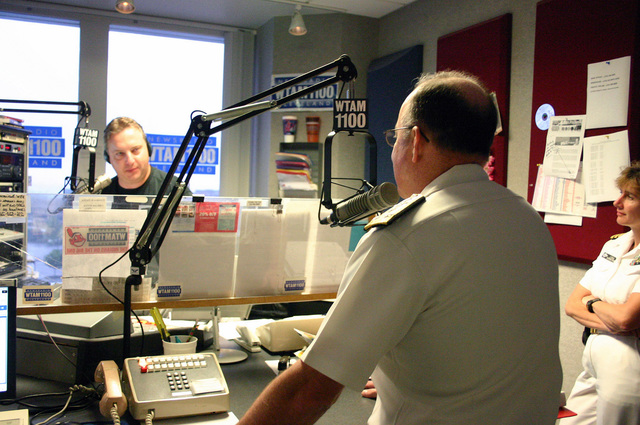 "U.S. Navy CHIEF of Naval Personnel Vice Adm. John C. Harvey Jr. is interviewed by popular radio host Bill Wills for a segment on WTAM""Wills and Coleman in the Morning""during Navy Week festivities in Cleveland, Ohio, on Aug. 29, 2006. Twenty-six such Navy Weeks are planned this year in cities throughout the U.S. arranged by the Navy Office of Community Outreach (NAVCO). NAVCO's mission is to enhance the Navy's brand image in areas with limited exposure to the Navy. (U.S. Navy photo by Mass Communication SPECIALIST 2nd Class Michael Sheehan) (Released)"