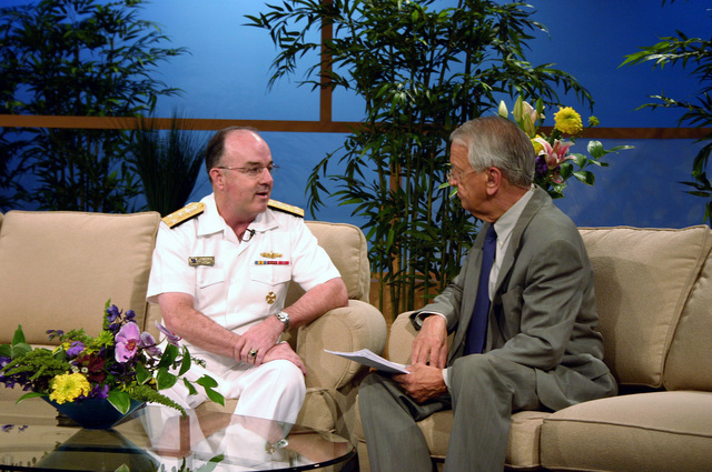 "U.S. Navy CHIEF of Naval Personnel Vice Adm. John C. Harvey Jr. is interviewed by Cleveland news personality Fred Griffith for a segment on WKYC-TV's morning talk show""Good Company""during Navy Week festivities in Cleveland, Ohio, on Aug. 29, 2006. Twenty-six such Navy Weeks are planned this year in cities throughout the U.S. arranged by the Navy Office of Community Outreach (NAVCO). NAVCO's mission is to enhance the Navy's brand image in areas with limited exposure to the Navy. (U.S. Navy photo by Mass Communication SPECIALIST 2nd Class Michael Sheehan) (Released)"