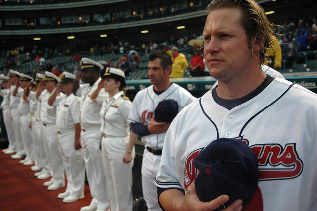 U.S. Navy Sailors join Cleveland Indians Jason Michaels, far right, during the playing of the national anthem at the start of a Major League Baseball game between the Cleveland Indians and Toronto Blue Jays at Jacobs Field, Cleveland, Ohio, on Aug. 28, 2006. The Sailors are participating in Cleveland Navy Week 2006, which runs from Aug. 28 to Sept. 4. Twenty-six such weeks are planned this year in cities throughout the U.S., arranged by the Navy Office of Community Outreach (NAVCO) to enhance Navy awareness in communities with limited Navy exposure. (U.S. Navy photo by Mass Communication SPECIALIST 1ST Class Jason J. Perry) (Released)