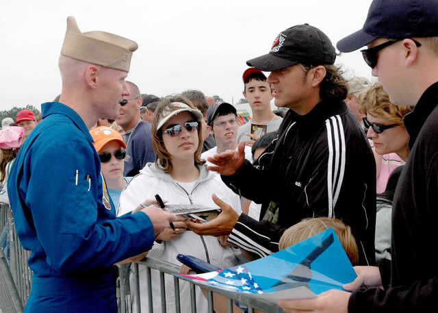 US Navy (USN) Lieutenant (LT) Anthony Walley, a member of the USN Blue Angels Flight Demonstration Team signs autographs during the Angels Over Atlanta 2006 Air Show held at Naval Air Station (NAS) Atlanta, Georgia (GA). The Blue Angels were the featured act as part of the Atlanta Navy Week 2006. Twenty such weeks planned by the Navy Office of Community Outreach are scheduled to visit cities throughout the Country