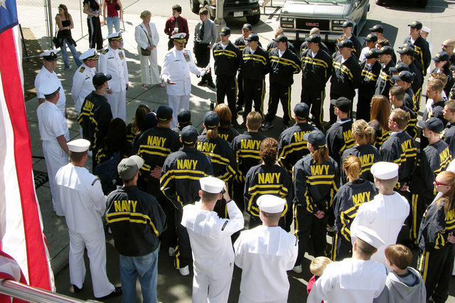 US Navy (USN) Rear Admiral (RADM) Albert Garcia III, Deputy Commander, 1ST Naval Construction Division, speaks with USN local area Delayed Entry Program members from Navy Recruiting District Denver, prior to their participation in the Navy Week Denver Cinco de Mayo Parade in Denver, Colorado (CO). Sponsored by the Navy Office of Community Outreach, Navy Week Denver is one of 20 such weeks planned this year in cities throughout the Country