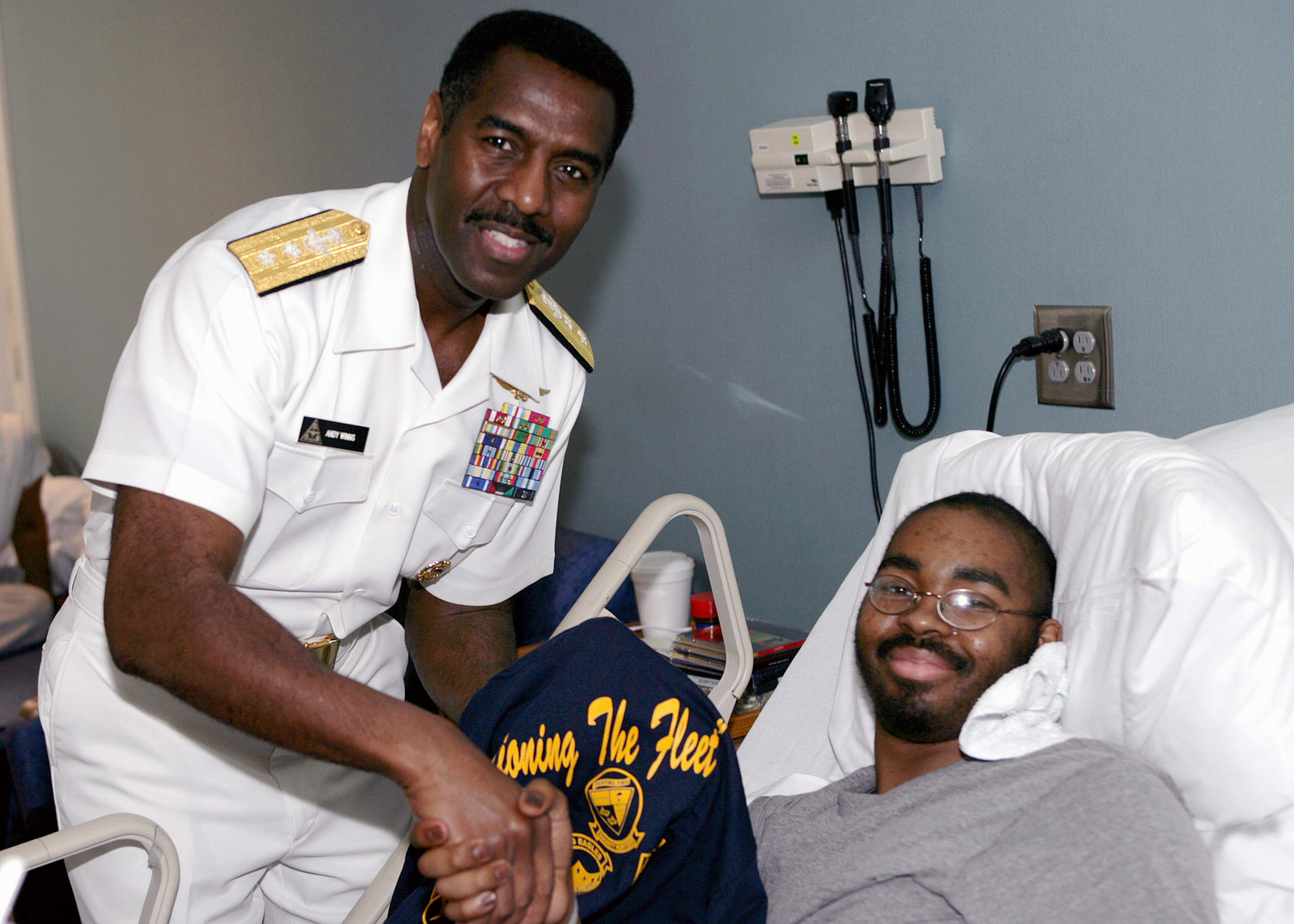 """US Navy (USN) Rear Admiral (RADM) Anthony Winns, Vice Director for Operations Joint CHIEF of STAFF, gives a Navy T-shirt to a youth at the Children's Hospital in Atlanta, Georgia (GA). RADM Winns participated in the """"Caps for Kids"""" program during his visit to Atlanta for the Navy Week 2006. Twenty such weeks arranged by the Navy Office of Community Outreach are planned this year in cities throughout the Country"""