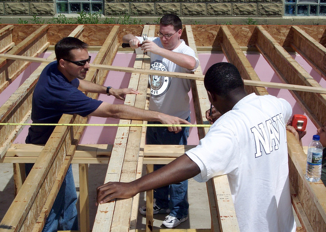 US Navy (USN) Sailors from Naval Hospital Great Lakes located in Chicago, Illinois (IL), giving back to the community by setting floor joists at a Habitat for Humanity construction project in Chicago's South Suburbs, during Navy Week Chicago. Sponsored by the Navy Office of Community Outreach, twenty such weeks are planned this year in cities throughout the Country