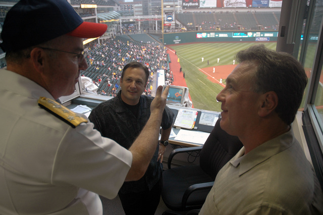 U.S. Navy Vice Adm. John C. Harvey Jr., CHIEF of Naval Personnel, chats with broadcasters from Cleveland radio station WTAM 1100 AM during a Major League Baseball game between the Cleveland Indians and Toronto Blue Jays at Jacobs Field, Cleveland, Ohio, on Aug. 28, 2006. Vice Adm. Harvey was participating in events kicking off Cleveland Navy Week 2006, which runs from Aug. 28 to Sept. 4. Twenty-six such weeks are planned this year in cities throughout the U.S., arranged by the Navy Office of Community Outreach (NAVCO) to enhance Navy awareness in communities with limited Navy exposure. (U.S. Navy photo by Mass Communication SPECIALIST 1ST Class Jason J. Perry) (Released)