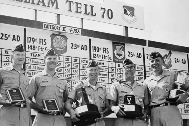"""U.S. Air Force personnel assigned to the 119th Fighter Wing""""Happy Hooligans"""", North Dakota Air National Guard, pose for a photo with winning trophies at the 1970""""William Tell""""Weapons Competition at Tyndall, Air Force Base, Fla. Left-to-right are CAPT. James P. Reimers, CAPT. Arthur E. Jacobson, MAJ. Wallace D. Hegg, MAJ. Allan B. Eide, and COL. Alexander P. Macdonald. (A3604) (U.S. Air Force PHOTO) (Released)"""