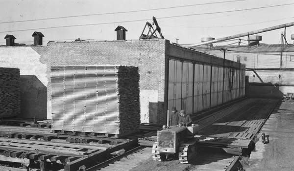 Photograph of Ed Johnvin and Dewey Spencer Hooking onto a Lumber Cart