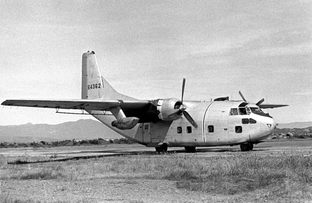 """A right front view of a parked UC-123K Provider aircraft of the 315th Tactical Airlift Wing. The aircraft, being inactivated, is named """"Patches"""" for the more than 1,000 hit-hole patches that it received during the Vietnam conflict"""