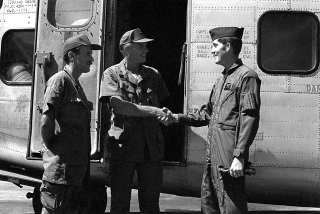 "COL Ray C. Staley, commander, 315th Tactical Airlift Wing, greets UC-123K Provider aircraft crew members. The members are SSGT W. Pase, left, and SSGT R. Christie. The aircraft, being inactivated, is named ""Patches"" for the more than 1,000 hit-hole patches that it received during the Vietnam conflict"