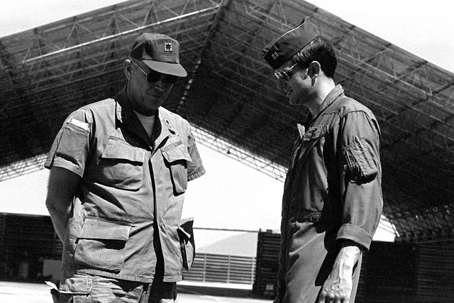 """LTC Slicker, commander, 310th Tactical Airlift Squadron, 315th Tactical Airlift Wing, talks with UC-123K Provider aircraft pilot CPT J. Greene. The aircraft, being inactivated, is named """"Patches"""" for the more than 1,000 hit-hole patches that it received during the Vietnam conflict"""