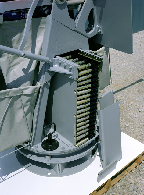 A close-up view of the placement of ammunition in the pedestal of a Mark 67/Mod 1 gun mount, which is being developed for use with the Mark 16/Mod 5 20 mm machine gun